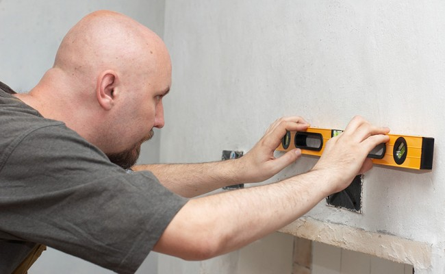 Worker measuring anger with level